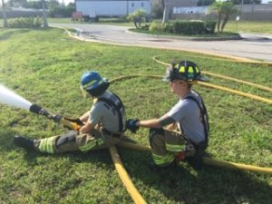 FF Muldoon training a probationary firefighter
